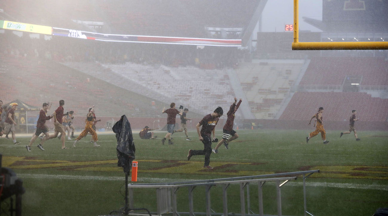 iowa-state-students-rush-field-at-jack-trice-stadium-during-weather-delay